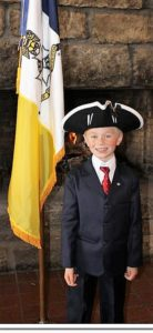 Junior member Colin Ladd gives the tricorn a try...dashing!