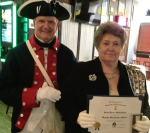 Fort Henry chapter president Jay Frey presented Wheeling Chapter DAR regent Joan McClelland with the Martha Washington medal and certificate for her outstanding support of the SAR.