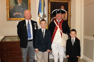 (l to r) Chapter genealogist Gary Auber, his grandson Braedon Wright, chapter president Jay Frey and Logan Wright.