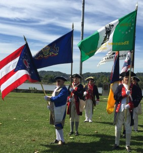 Pictured in the SAR color guard at Battle Days, October 4, 2015 are Compatriots Gary Timmons (bearing the Pennsylvania state flag) and Merle Tomlinson, president of the Ebenezer Zane Chapter, St. Clairsville, OH (bearing the green and white chapter flag)