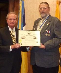 WVSSAR president Steven D. Hart presents the Chapter Charter to president Jay Frey at the organizational dinner.