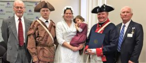 (Left to right) Chapter secretary-treasurer Dale Smith, member Gary Timmons, Jessica and Emily Keller of Fort Henry Days Living History, chapter president Jay Frey and chapter genealogist Gary Auber